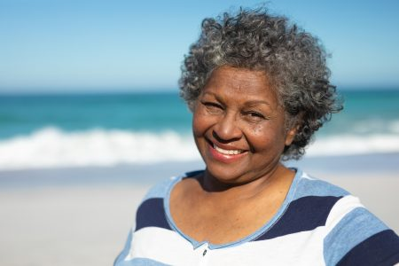 old-woman-smiling-at-the-beach